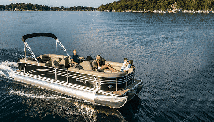 A luxury Pontoon boat cruising over still waters