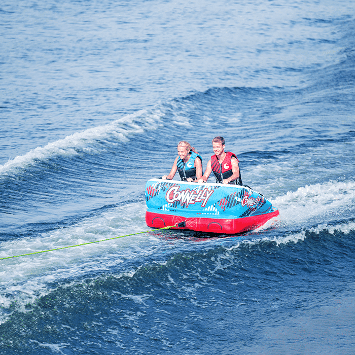 A couple enjoying a tubing experience