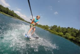 A happy child water skiing